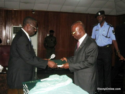 Hon Justice Aloy Nwankwo presenting the copy of the laws to the Governor